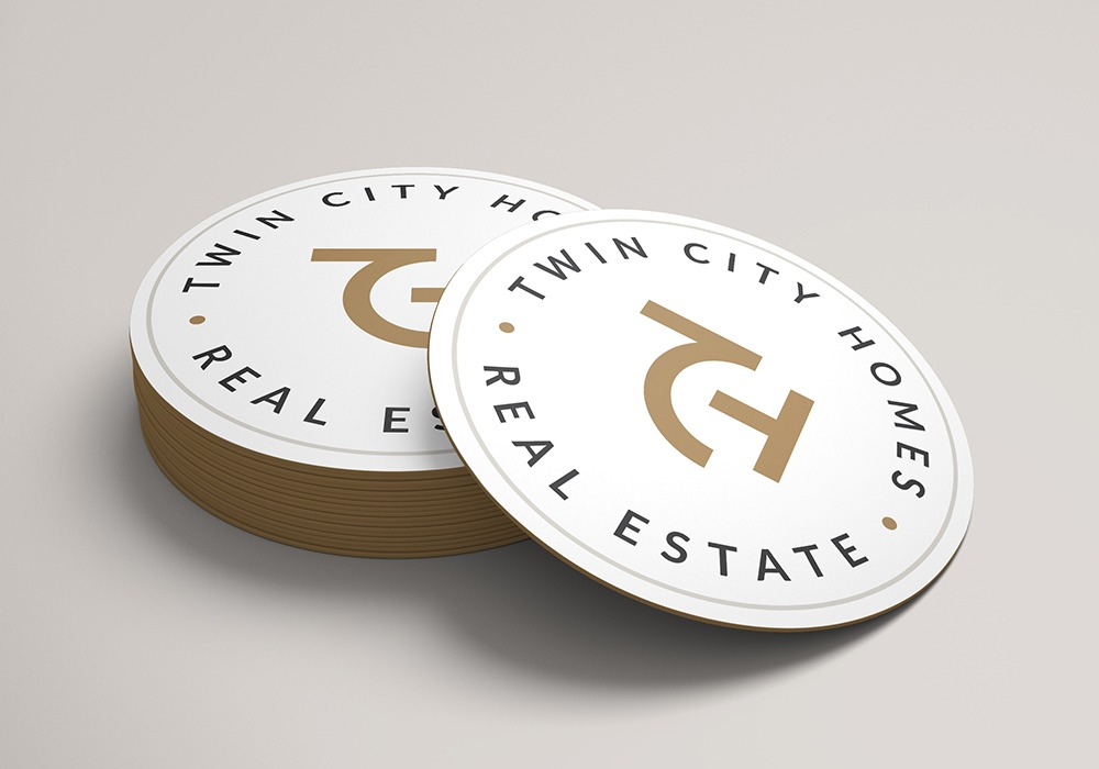 Twin City Homes coasters with logo