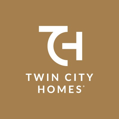 Twin City Homes white logo on gold